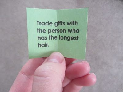 Some suggested gift-exchange instruction slips:  Trade gifts with... the person who has the longest hair the person to your right/left the person whose gift wrap has the most red on it the person with the smallest/biggest gift the person with the biggest smile a person wearing green/red the person whose birthday is closest to Christmas