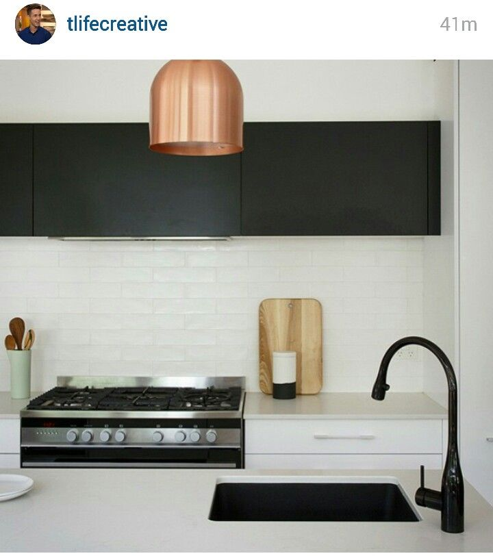 Black and white kitche with mint and metallic. Like this kind of uneven subway tile