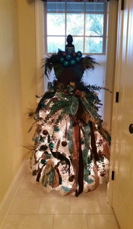 So here's my 2015 mannequin Christmas tree for our powder room. Chocolate & teal with peacocks. I absolutely LOVE it. The picture does NOT do it justice. #themostwonderfultimeoftheyear