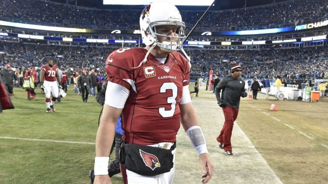 Jan 24, 2016; Charlotte, NC, USA; Arizona Cardinals quarterback Carson Palmer (3) walks off the field after the NFC Championship football game against the Carolina Panthers at Bank of America Stadium. The Panthers won 49-15. Mandatory Credit: John David Mercer-USA TODAY Sports