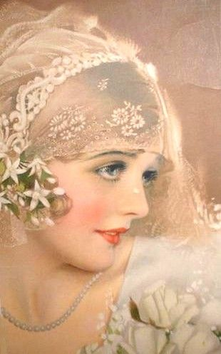 Classic soft 1920s make up: the blushing bride look with small lips, darkened eyes and thin, downward brows.