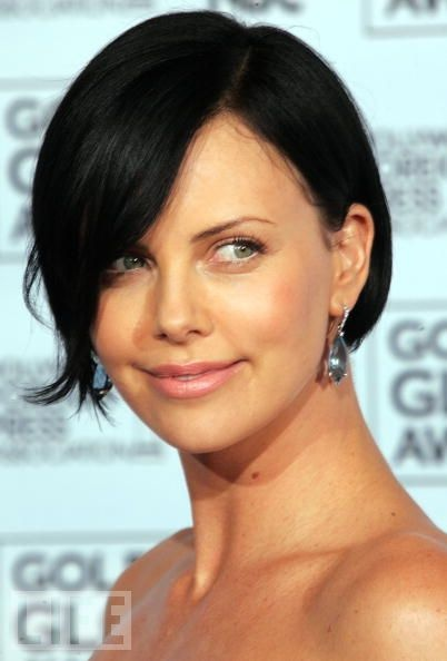 Charlize Theron with dark hair...