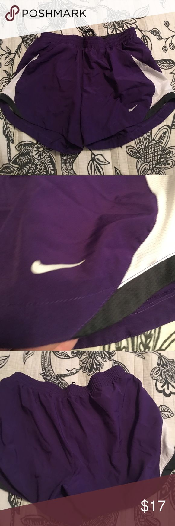 Nike tempo short size small purple Nike deep purple tempo run shorts. Nike heck on front is peeling a bit. Shorts