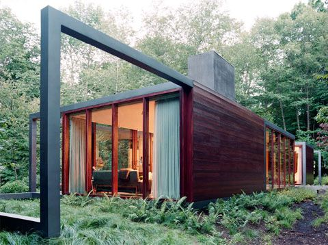 Beautiful glass guesthouse features a black metallic steel structure, living room, kitchen, two bedrooms & bathrooms in Dutchess County, NY by Allied Works.