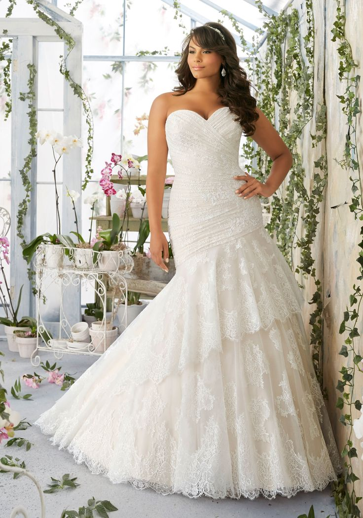 Asymmetrically Draped Chantilly Lace with Scalloped Edging on the Tiered Tulle Skirt Plus Size Wedding Dress. Designed by Madeline Gardner.