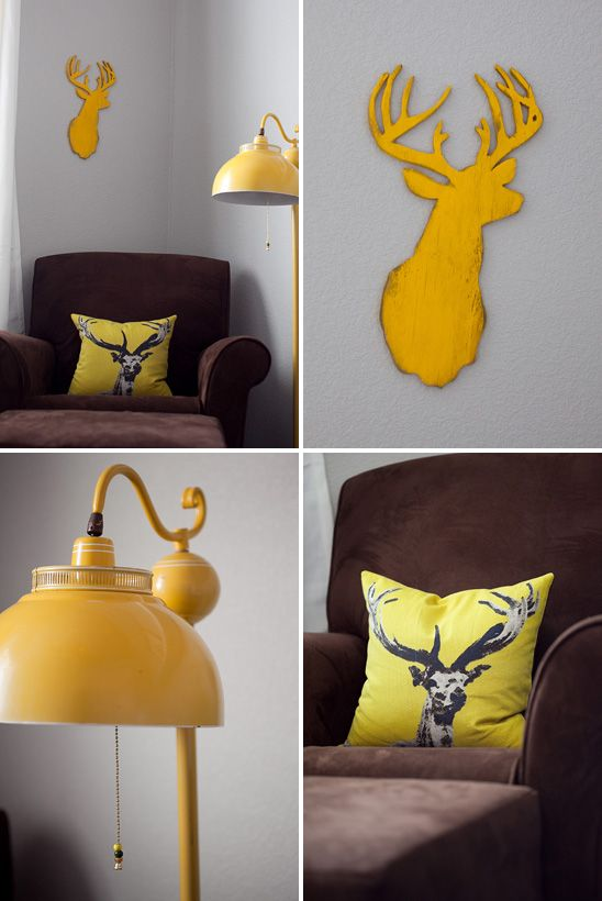Classy Use Of A Deer Head In This Gray And Yellow Woodland Themed Nursery