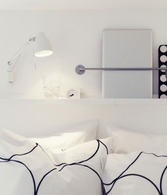 A shelf with a BYGEL rail makes a bedside home for your laptop. So after you update your status, you can roll over and go right to sleep.
