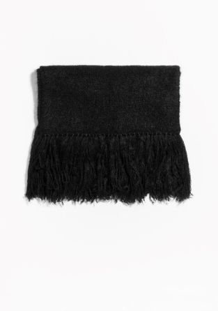 A fuzzy, loosely knitted scarf accented with long finged edges. Crafted from mohair blend, it is designed for a voluminous fit.