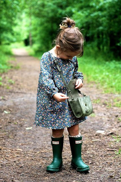 such an adorable outfit for a little girl! love th boots, the dress, the cute ponytail and the purse. :)