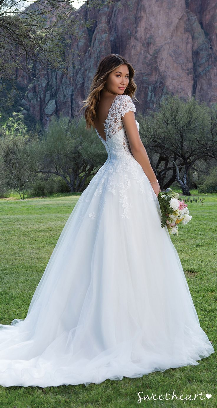 Style 1134: Embroidered lace refines this Sabrina neckline wedding dress. With f…