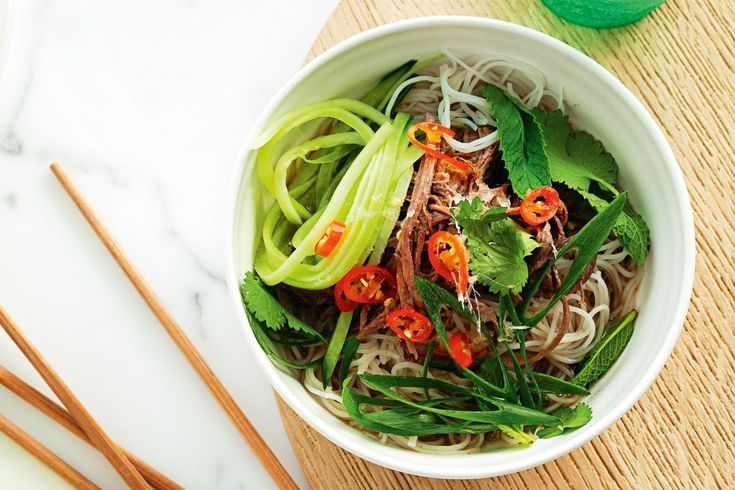 This slow-cooked Asian beef stock is worth the wait. Served with noodles and spicy herbs, it's a great winter warmer.