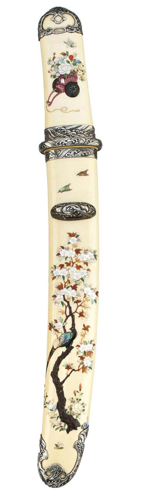 A Fine Shibayama Tanto Koshirae  Meiji Period (late 19th century)  Inlaid in Shibayama style with a pheasant in a blossoming cherry tree, the reverse with birds and flowers, engraved silver fittings with waves, containing a tanto blade with horimono of Jogeryu [ascending and descending dragons], gilt clad habaki, Edo Period (19th century)