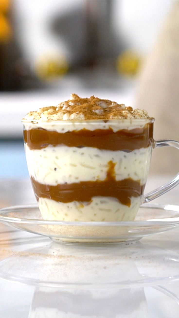 Recipe with video instructions: Parlez vous parfaits? Oui, it's the perfect dessert! Ingredients: 1 cup rice, 2 cloves, 1 cinnamon stick, 4 ¼ cups milk, 1 can condensed milk, Ground cinnamon, 1 cup dulce de leche