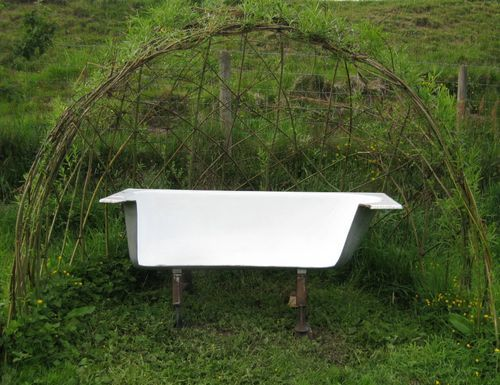 Garden bench made from old bathtub