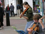 Got a few musicians on your team? A magician? Anyone great at front flips? Put on a street performance! Here's some tips...