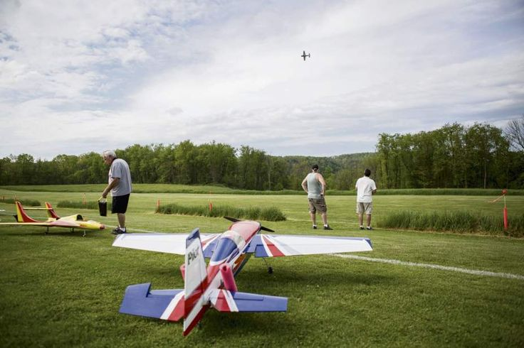 Patrick Connolly | Tribune-ReviewJeff Dzikowski of White Oak (right), flies his radio-controlled plane while Scott Stiehl of Hazelwood (center) observes and Ray D'Andrea of Latrobe readies his plane at 'The Sky's the Limit' celebration on Thursday, May 12, 2016, at Cedar Creek Park in Rostraver. The event was held to celebrate the addition of 28 more acres of land to the Westmoreland County park and permission for hobbyists to fly their planes, helicopters and drones.