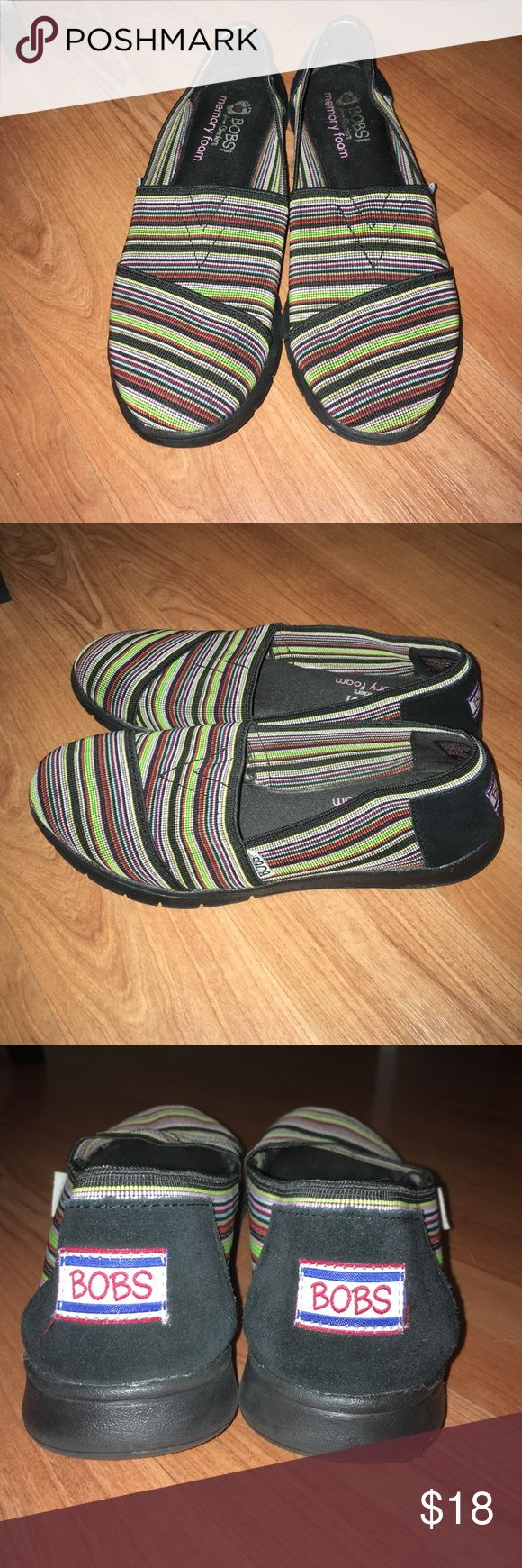 Bobs sport from Skechers memory foam 8.5 used Used still good condition. The memory foam is so comfortable. Multi colored stripes black, yellow,pink,white, neon green, red, brown, baby blue, and a few other colors. A little bit of faded logo inside where foot sits. Bobs Shoes