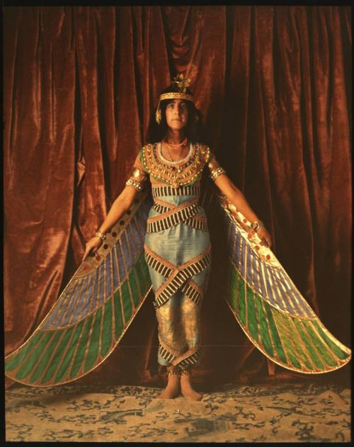 Dancer wearing Egyptian-look costume with wings reaching to the floor (1915)