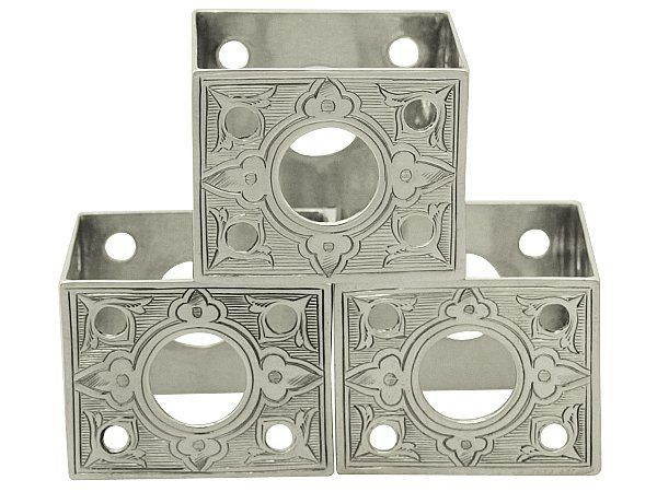 'Victorian Napkin Rings' http://www.acsilver.co.uk/shop/pc/Sterling-Silver-Napkin-Rings-Set-of-Three-Antique-Victorian-58p7017.htm