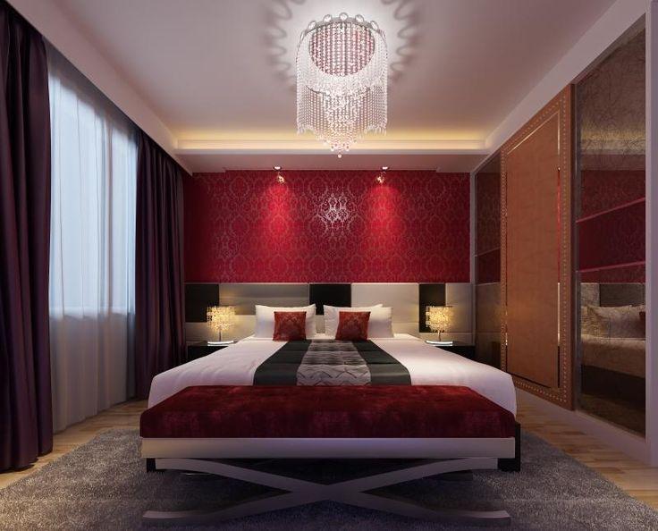 chambre rouge | chambre rouge avec un grand lit et suspension de design original