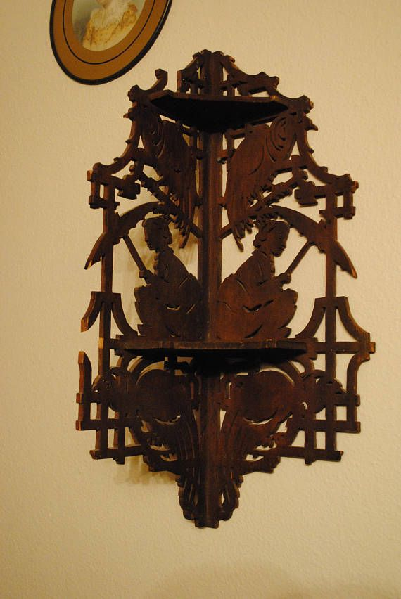 Unmarked carved wooden corner shelf with Asian theme