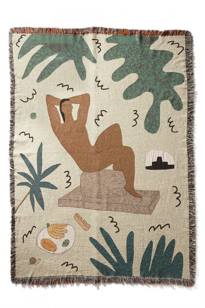 Los Angeles-based designer Lilian Martinez produces blankets printed with tropical motifs such as palm fronds, papaya's and topless men and women.