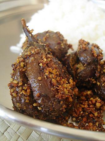 Vankaya karam petti kura - Stuffed brinjals roast1/4 kg purple brinjals, wash, make + quarters with stalk intact and apply oil 1 tbsp oil few curry leaves For stuffing: 1 1/4 tbsps coriander seeds 3 tbsps channa dal/ 1 1/2 tbsps urad dal/ 2-3 dry red chillis,  1/2 tsp cumin seeds pinch of methi seeds big pinch/hing/ small  sized tamarind salt to taste