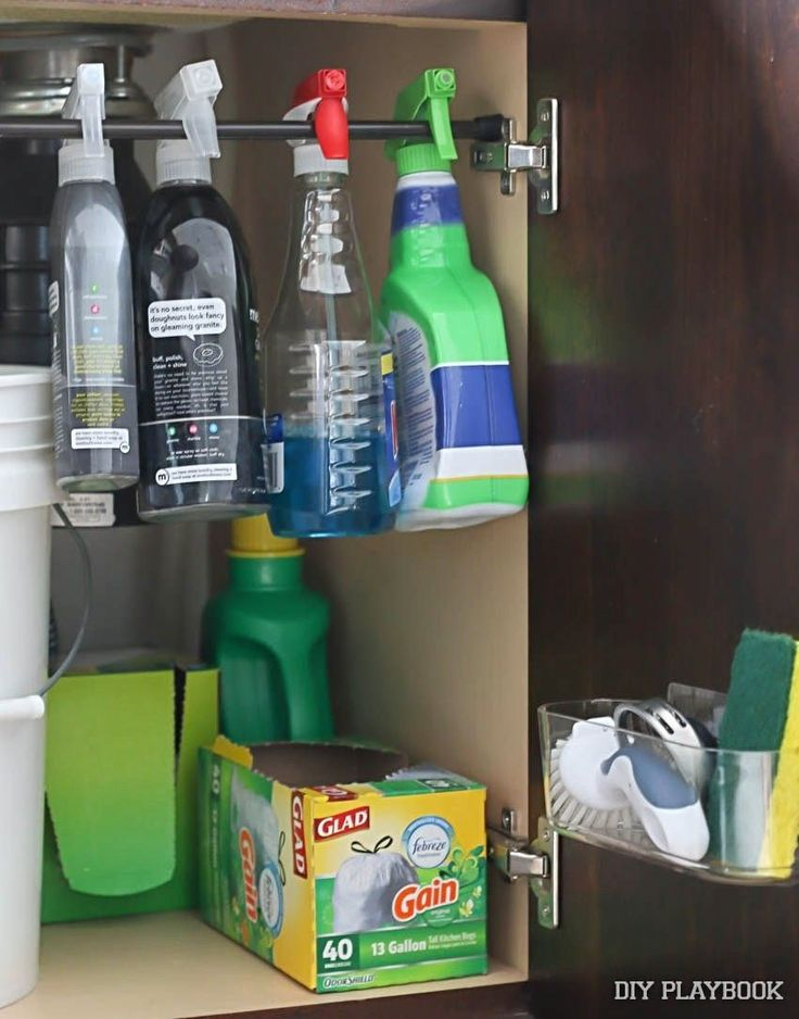 Don't let the space beneath your sink go to waste. Install a tension rod for hanging cleaning bottles. Check out other clever ideas from DIY Playbook!
