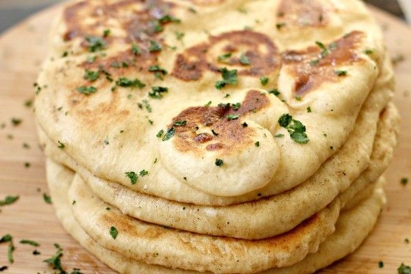 An easy recipe for homemade naan bread, so you can make your own Indian dishes at home.