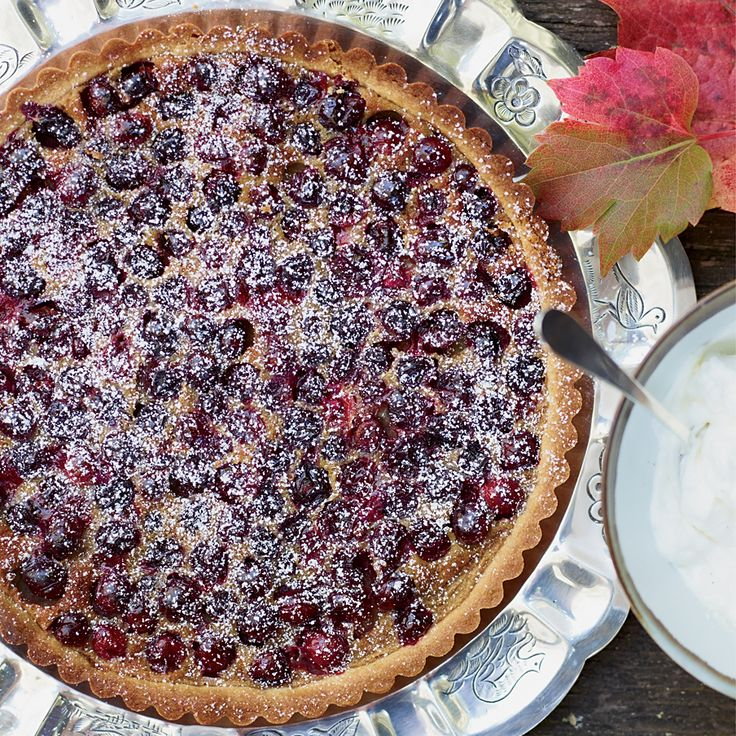 The sweet-and-tart berries in the creamy custard pop when you take a bite of this buttery French-American tart.