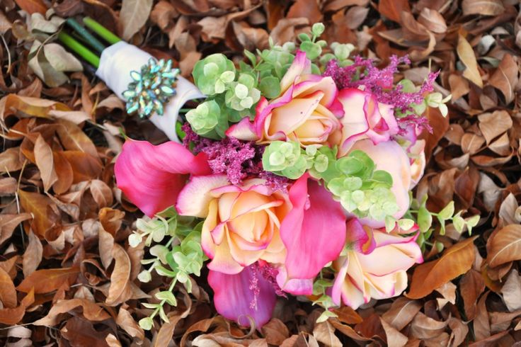 Bouquet made from artificial roses, calla lilies, astilbe, eucalyptus and peaches. For the how-to, go to http://www.acoloradocourtship.com/2012/10/21/artificial-bouquet/#