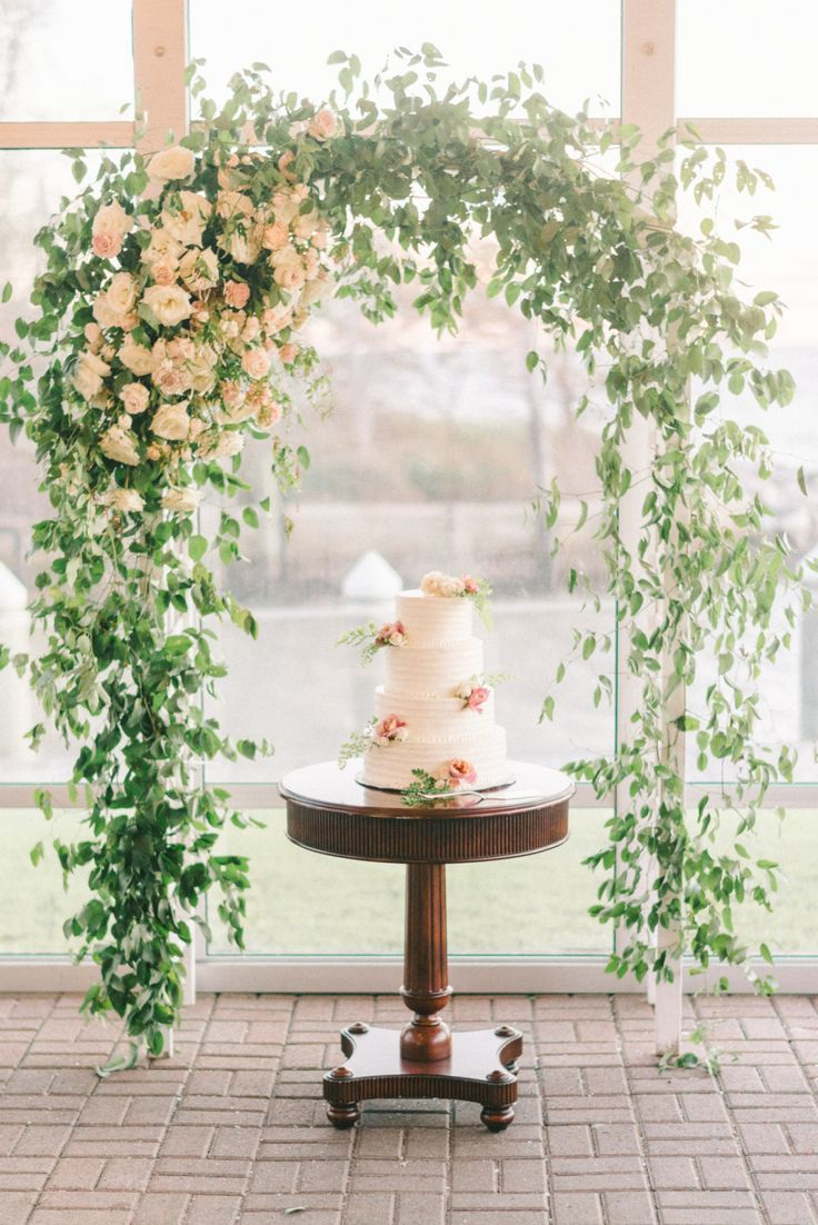 Wedding arch and wedding cake: Venue: Silver Swan Bayside - http://www.stylemepretty.com/portfolio/silver-swan-bayside Floral Design: Blossom & Vine - http://www.stylemepretty.com/portfolio/blossom-and-vine Photography: Elizabeth Fogarty - elizabethfogartyphotography.com/   Read More on SMP: http://www.stylemepretty.com/2017/03/16/this-maryland-fall-fete-is-the-definition-of-timeless/