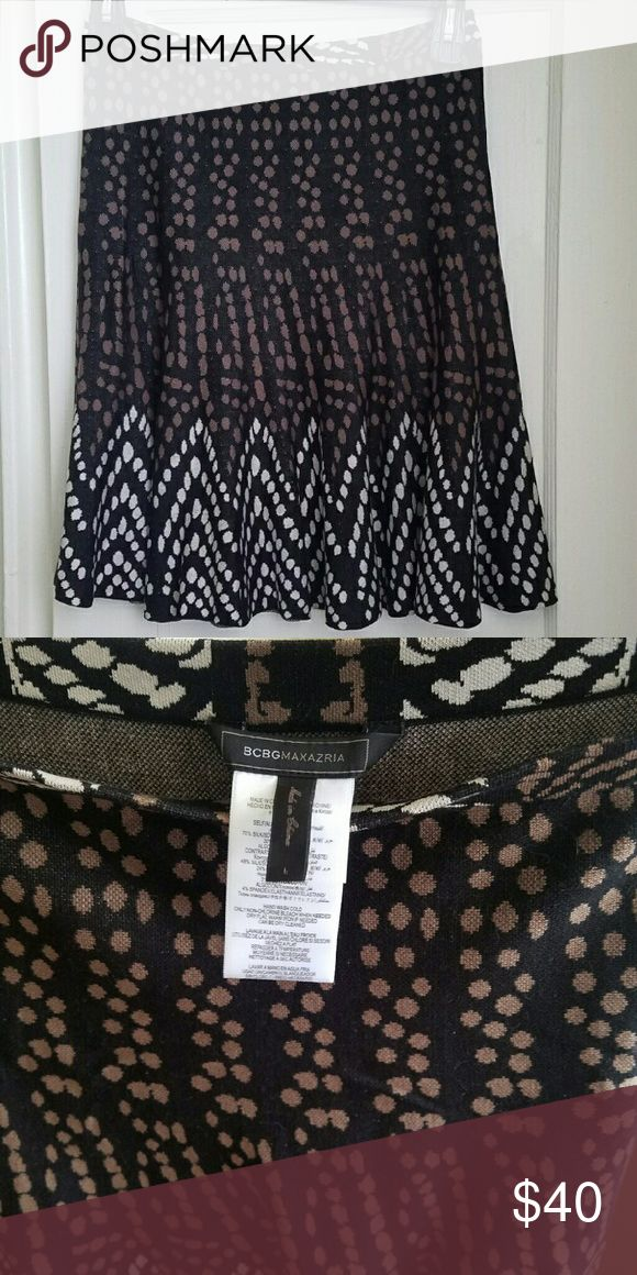 """BCBGMAXAZRIA skirt Flippy BCBGMaxAzria skirt. Features brown and cream spots against a black background. Unlined. Fabric is 70% silk, 30% cotton and has some stretch.  Measurements when laying flat: 14.75"""" across waist, 22"""" long  Flexible with offers, but no trades please. BCBGMaxAzria Skirts"""