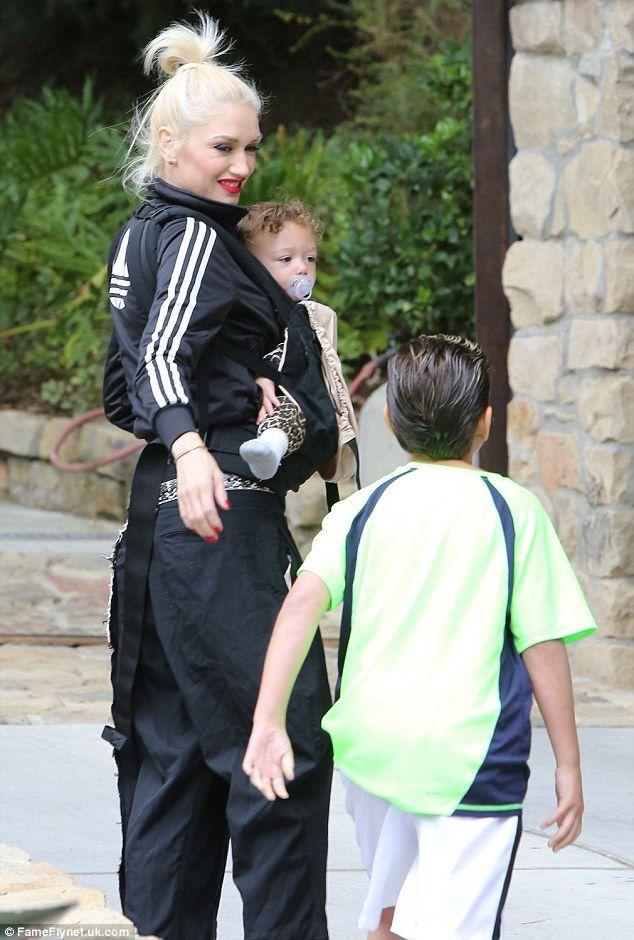 Gwen Stefani wears her trademark Adidas tracksuit jacket ...