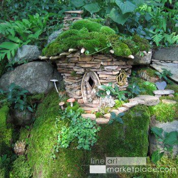 Garden Stone Faerie Hut by Sally J. Smith -- A wee garden hut for the faeries made of sandstone with willow twig windows & a moss roof w/ stepping stones leading along a mossy cliff.