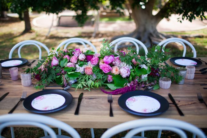 botanical beauty styled shoot   outdoor wedding   inspiration   private property   perth   western australia   furniture hire   wedding ceremony   long table dining   spring   wedding stylist   blue suit   bow tie   pink table arrangements   marri long timber table   black crockery   watercolour menus    white bentwood chairs   garden wedding   collaboration   Featured on First Comes Love with images by Amelia Clair Photography