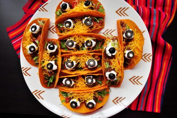 """These are a sight to see. I originally made them after finding the recipe last year for Halloween and have since changed the recipe around to make them more eater-friendly. The smiles you will receive are priceless! Try to find the widest taco shells possible if you are not making your own. We call them """"Johnny 5 Tacos"""" as they resemble the robot from the movie Short Circuit more than they seem spooky. Kids also love to help prepared these!"""