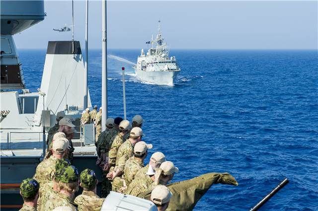 The crew of Her Danish Majesty's Ship ESBERN SNARE watch a sail past of HMCS Regina on June 12 during Operation REASSURANCE in the Mediterranean Sea. Information and photos courtesy of the Royal Canadian Navy. Photos by Cpl Michael Bastien, MARPAC Imaging Services.