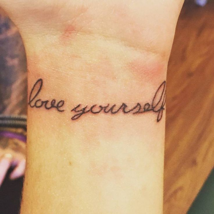 "Little wrist tattoo saying ""Love yourself first"" on Michela."