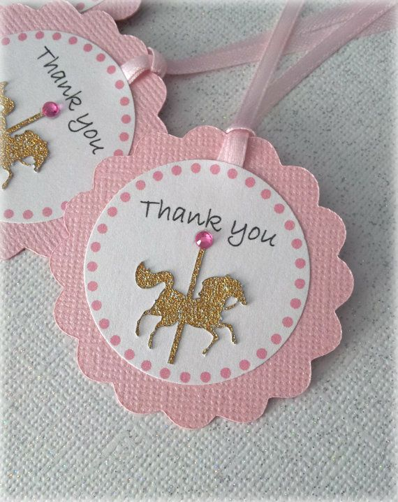 *Please read my shop announcements page for current processing times!* These gorgeous favor tags are made of acid free textured cardstock in a baby pink color and feature a gold glitter carousel horse and the phrase Thank you or your custom choice of wording. The inner circle is made of a beautiful pearl finish paper for added glamour. They include a satin ribbon to attach to your party favor! Please select your options from the drop down menu: with jewel or without jewel (not pictured). ...
