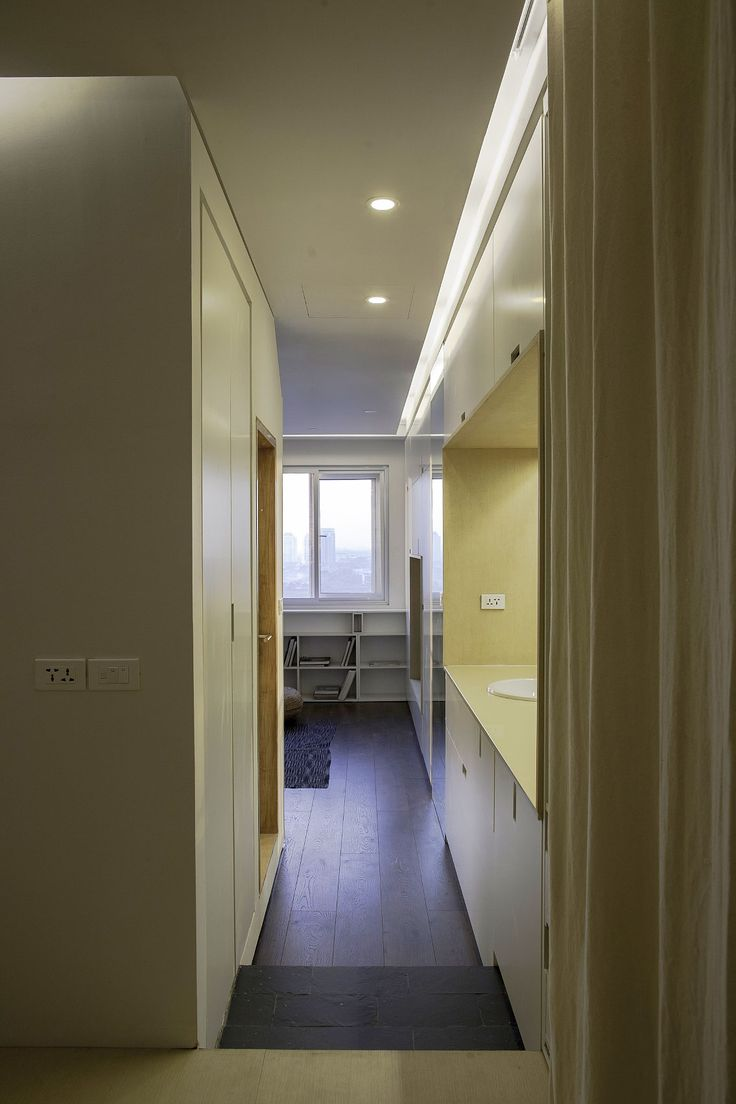 Apartment Renovation under Hanoi Home Interior as Hallway Design Decorated Among Wooden Flooring Also Minimalist Decoration Ideas as Home Inspiration
