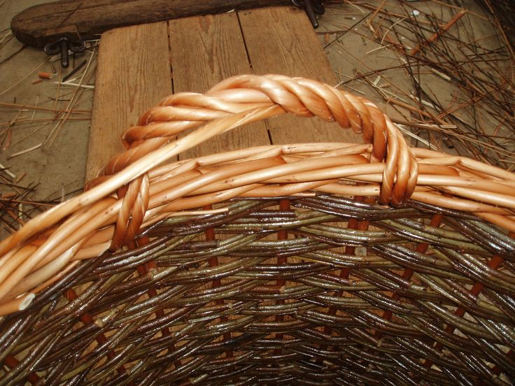 Finally the original rod, which formed the hoop at the beginning is twisted and woven around the hoop, filling in the gaps.  It will be tied-off on the left hand side.