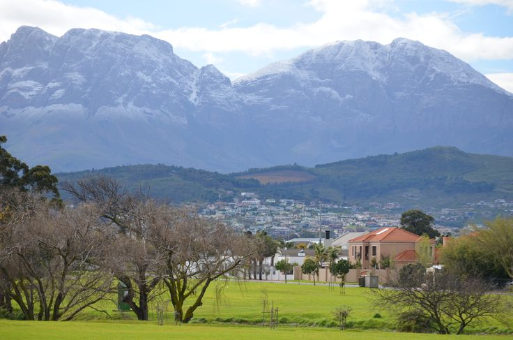 Winter views of the Hottentots-Holland mountain range from the conservation area around the Lourens River in Strand. Goedehoop suburb to the right of the river.