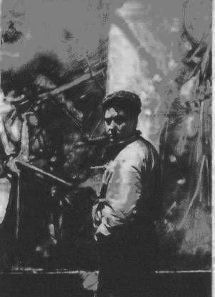Roberto Matta en medio de la producción de una de sus pinturas.