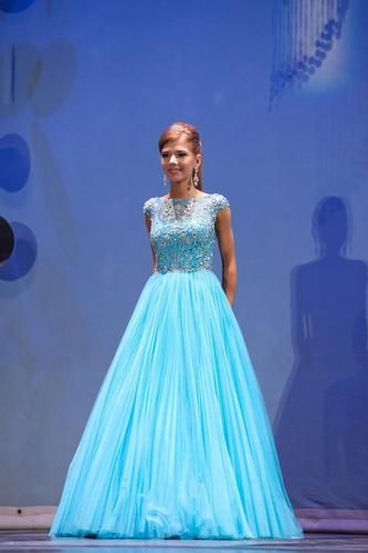 Sherri Hill Aqua #2984. Originally $670, worn twice for local and high school pageant. Perfect teen dress!!! Has been altered from an 8 to a 2. There is some room to reverse to make larger if needed. Absolutely gorgeous dress and sparkles on stage!!!