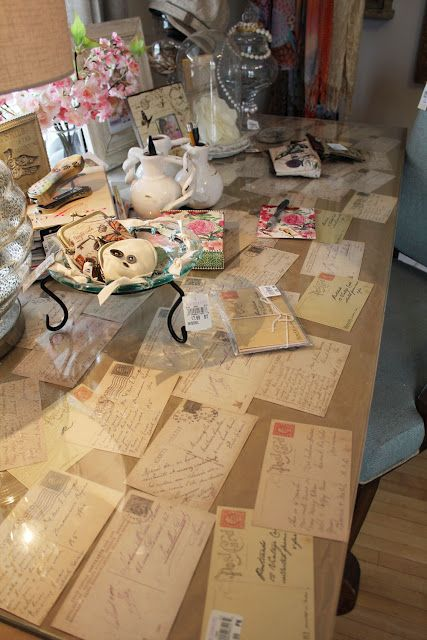 Cards/letters under glass desk top. Have you and your significant other written love notes to each other? How about putting excerpts from those letters onto cards and displaying them under a glass-top table during your wedding?