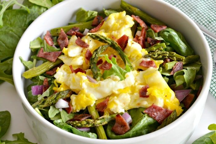 Start your day with an energizing bowl of produce topped with eggs. This Eggs Benedict Salad has gone green and lean with a mega loss in calories and boost of nutrition.