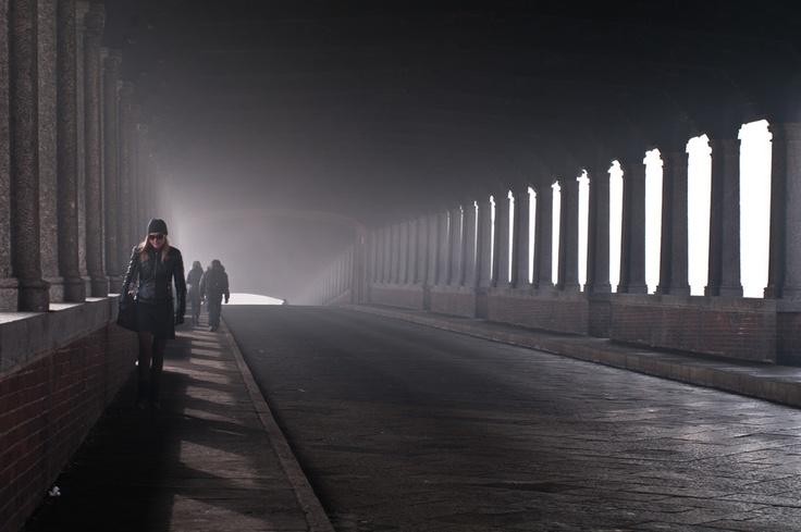 """The Ponte Coperto """"covered bridge"""" is a brick and stone arch bridge over the Ticino River in Pavia, Italy."""