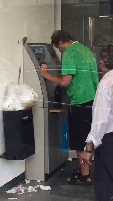 Drunk Guy Tries To Use Cash Machine, Doesnt Do Very Well