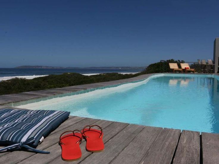Seascape - SeaScape is perched on the edge of beautiful Keurboomstrand. This is a lovely 5-bedroom holiday villa, ideal for large groups. There is an open-plan living area with a well-equipped kitchen, a comfortable ... #weekendgetaways #keurboomstrand #gardenroute #southafrica